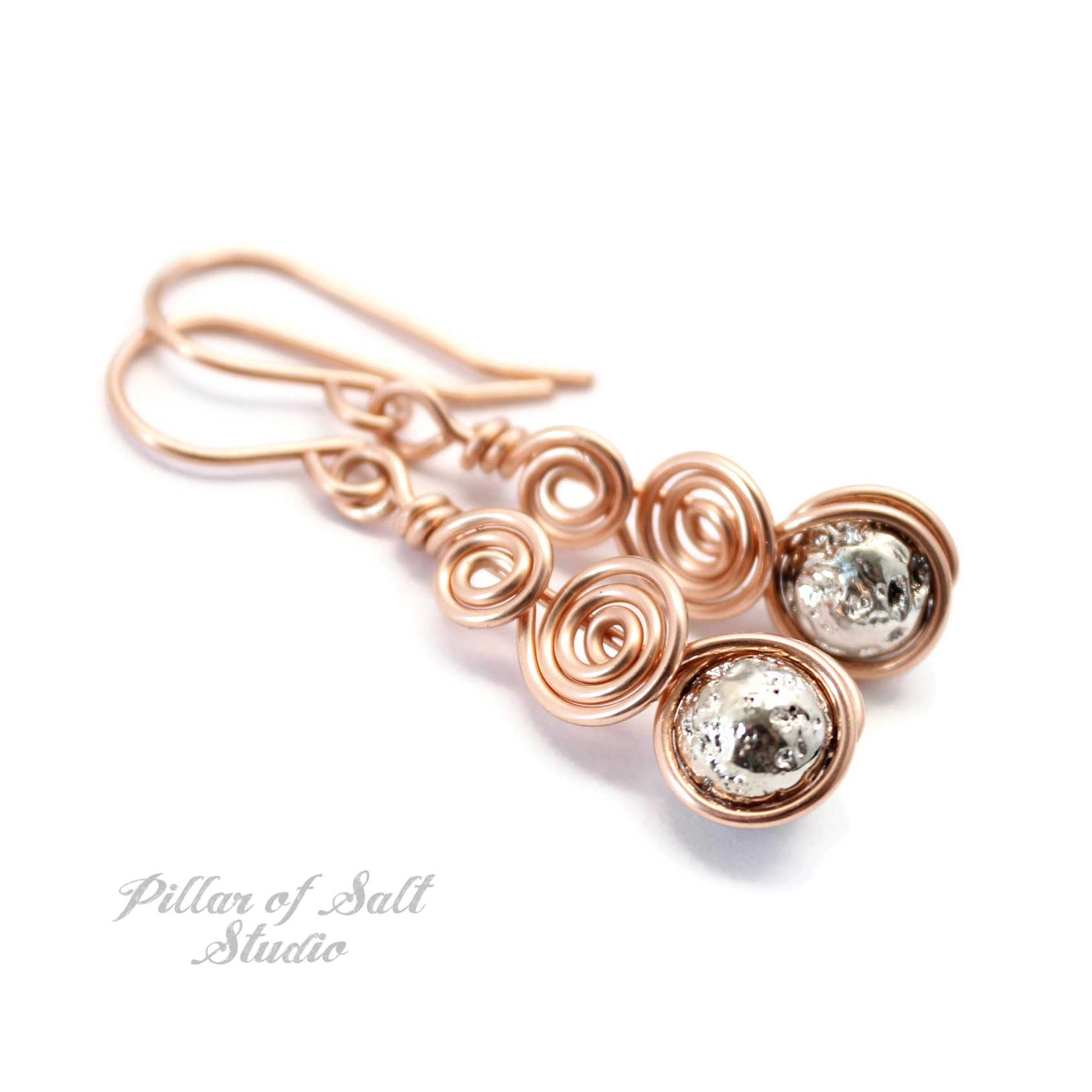 rose gold wire wrapped earrings with silver colored lava rock