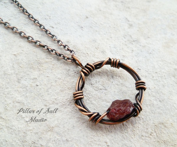 barbed wire circle pendant with garnet gemstone by Pillar of Salt Studio