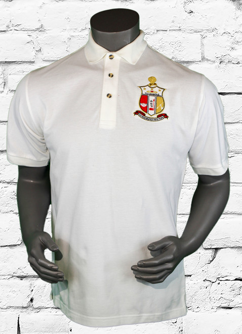 Kappa Alpha Psi (ΚΑΨ) Classic Polo is an all white cotton pique short sleeve polo with an oversized fraternity shield embroidered on the left chest area. The right arm is embroidered with red 1911 design.