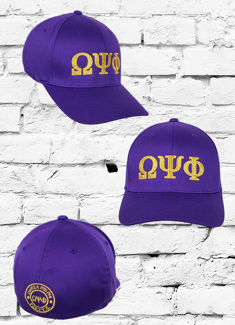 """Omega Psi Phi (FIETTTS) fitted cap is a staple in every Ques collection. This purple fitted cap feature large gold greek symbols on the front panel and """"FRIENDSHIP IS ESSENTIAL TO THE SOUL"""" logo on the rear."""