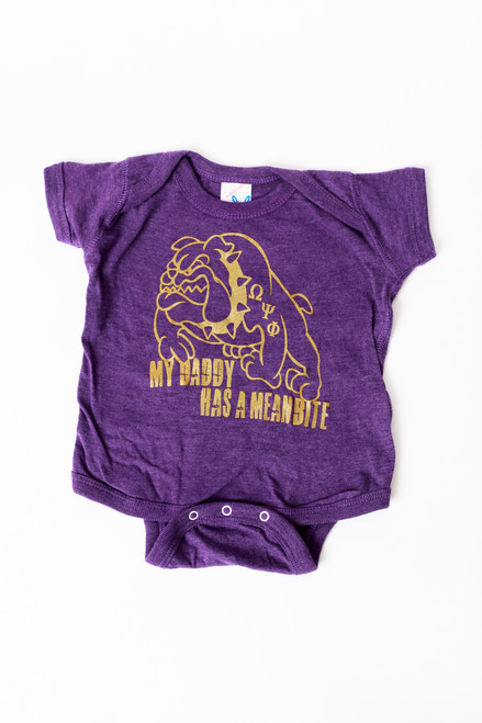 """The """"My Daddy Has A Mean Bite"""" onesie is a purple 100% cotton onesie design for the child of A member of  Omega Psi Phi Fraternity Inc."""