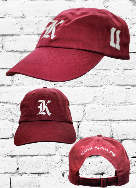 """Kappa Alpha Psi #11 vintage cap is a classic crimson dad cap. Embroidered white front Kappa """"K"""", left side embroidered line number and rear Kappa Alpha Psi lettering."""