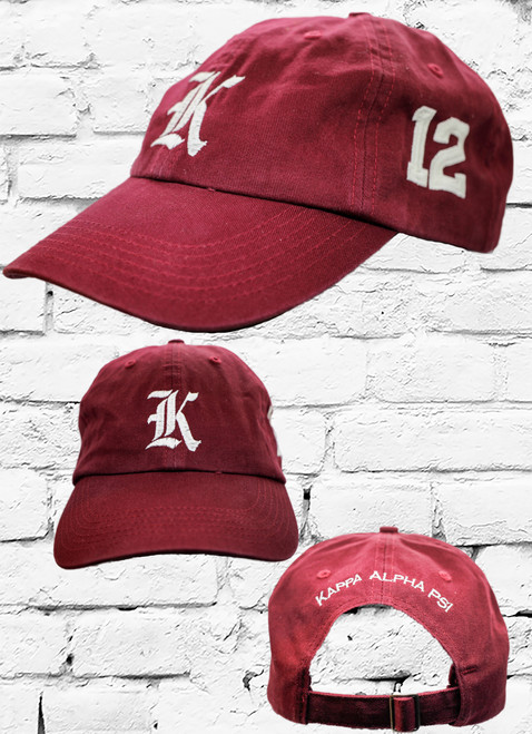 """Kappa Alpha Psi #12 vintage cap is a classic crimson dad cap. Embroidered white front Kappa """"K"""", left side embroidered line number and rear Kappa Alpha Psi lettering."""