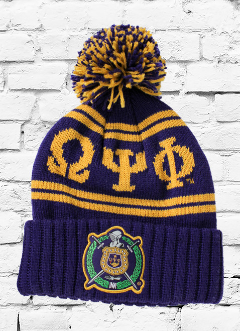 This Omega Psi Phi knit winter beanie is a cuffed knit with ΩΨΦ and 1911 graphics on the crown, stitched ΩΨΦ escutcheon on the front, and plush pom pom at top.