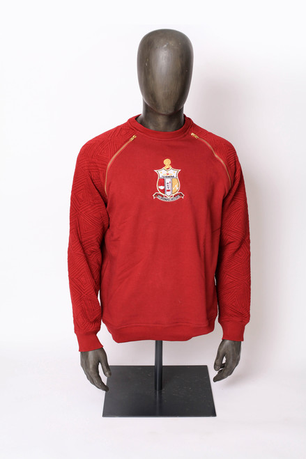 Crimson Kappa Alpha Psi raglan sweatshirt is perfect for any weekend event. This sweatshirt  has a embroidered ΚΑΨ shield on the center chest and gold zippers in both shoulders.