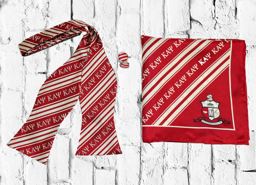 ΚΑΨ Bow Tie set is a sophisticated staple perfect for any dress occasion. Crimson and Cream bow tie, cuff links, and pocket square.