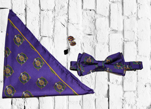 ΩΨΦ Bow Tie set is a sophisticated staple, perfect for any dress occasion. Purple and Gold bow tie, cuff links, and pocket square.