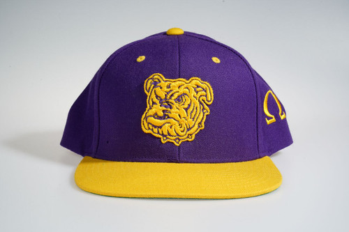 The ΩΨΦ Dawg  two tone snapback cap features an allover purple fabrication with gold bill with gold Dog embroidered at the front panels and an embroidered Ω symbol on the side panels.