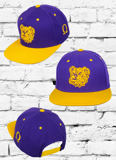 The Omega Psi Phi Dawg Fitted Cap features two-tone fabric with a Bull-Dog logo embroidered at the front panels using a 3D embroidered technique and a Ω symbol at the right-wear side.