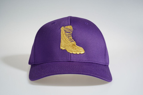 The ΩΨΦ Gold Boot  Fitted Cap features an allover purple fabrication with gold boot embroidered at the front panels and an embroidered 1911 script at the back panels.