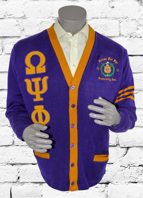 Purple and old gold ΩΨΦ cardigan sweater with chenille patches and an embroidered Omega Psi Phi escutcheon.