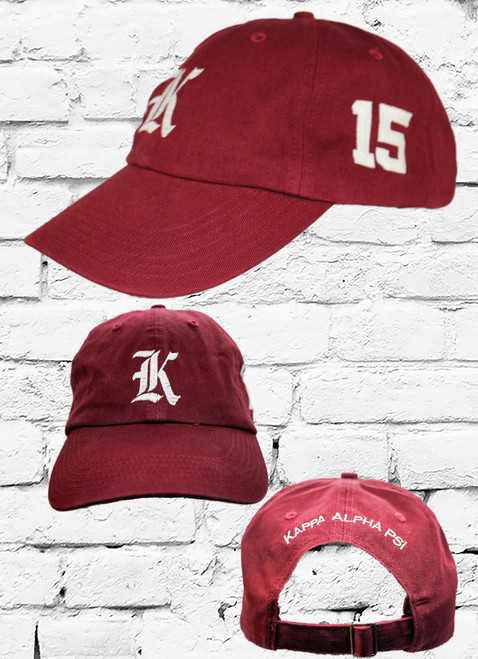 """Kappa Alpha Psi #15 vintage cap is a classic crimson dad cap. Embroidered white front Kappa """"K"""", left side embroidered line number and rear Kappa Alpha Psi lettering."""