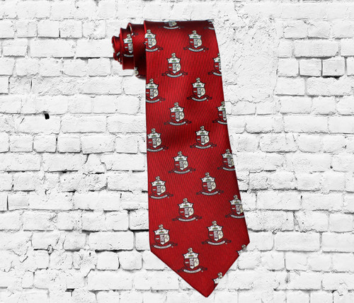 Kappa Alpha Psi 100% silk woven tie. This tie is covered in the ΚΑΨ Fraternity Coat of Arms and designed using the fraternity colors.