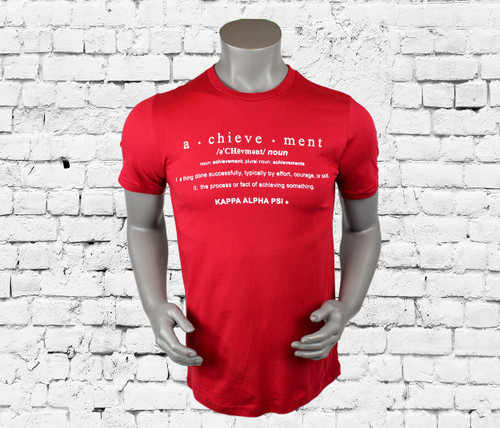 """Kappa Alpha Psi T-Shirt. Crimson colored shirt with white screen printed design on front. The front design contains Kappa Alpha Psi and the definition of """"Achievement"""". -100% Cotton Tee"""