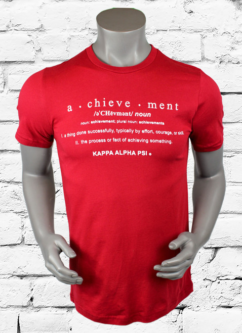 "Kappa Alpha Psi T-Shirt. Crimson colored shirt with white screen printed design on front. The front design contains Kappa Alpha Psi and the definition of ""Achievement"". -100% Cotton Tee"
