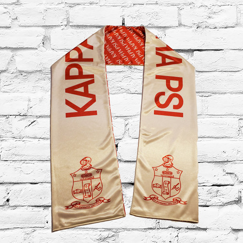 Kappa Alpha Psi double sided scarf. The scarf color are base of the official fraternity colors. Side one has a cream base with Kappa Alpha Psi and the fraternity shield in crimson. Side two has a crimson base and cream Kappa Alpha Psi all over print.