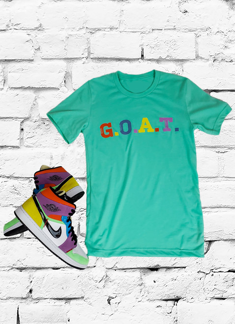 This G.O.A.T. (God Over All Things) t-shirt pops with bright spring colors against an ultra soft crewneck tee that acts like a canvas for this artistically color inspired design across the chest.