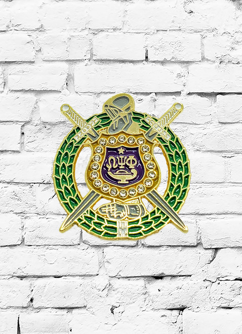 The Omega Psi Phi escutcheon lapel pin is a 1 inch purple and gold soft enamel color filled design with 20 inlayed crystals.