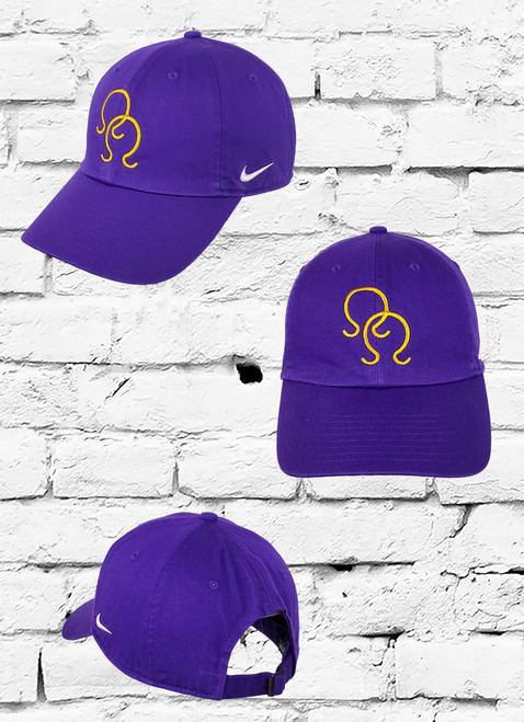 "Double Hit Omega dad cap. This low profile purple Nike dad cap features old gold embroidered ""Ω"" symbols on the front panels and a white Swoosh on the side."