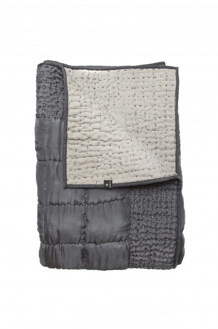 silk Delia bedspread in dark grey.