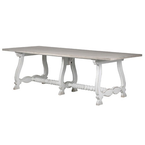 A elegant white washed dining table with a detailed set of legs and a lovely turned central support.