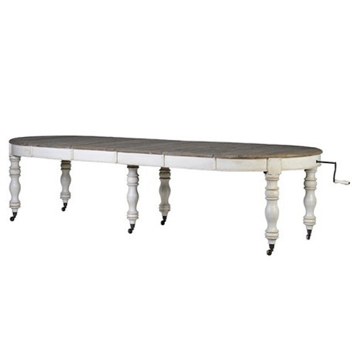 A beautiful white oval extending dining table with a farmhouse style leg. Please note that the top of this item is produced from reclaimed, weathered pine. As it is a recycled wood, each piece will differ and have natural imperfections.