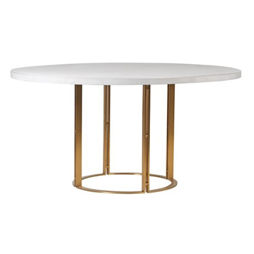 A solid white concrete top dining table with a matt gold metal frame