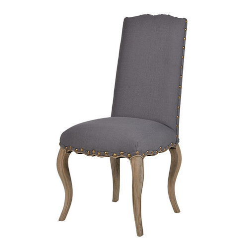 Grey upholstered linen dining chair with carved wooden legs.
