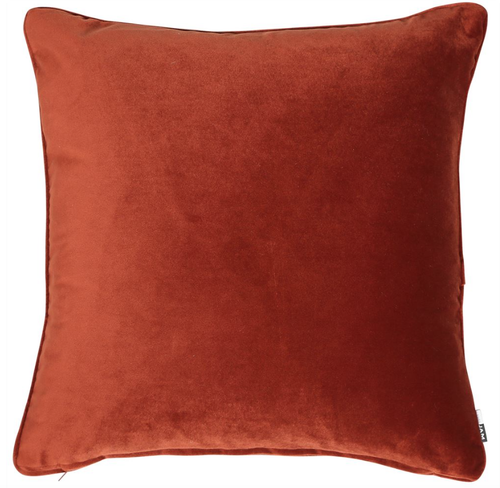 Luxe, plain, matte velvet cushion in a paprika colour, matching piped edge detail.