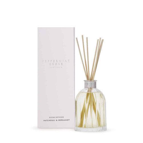 Patchouli and bergamot reed diffuser with shaped glass bottle and gift packaging
