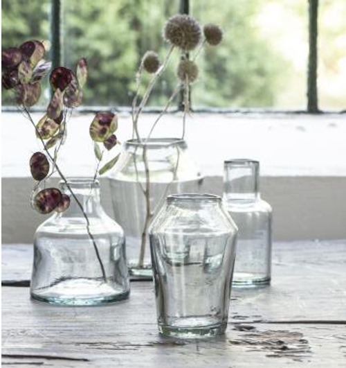 delicate unusually shaped conical vase is hand blown