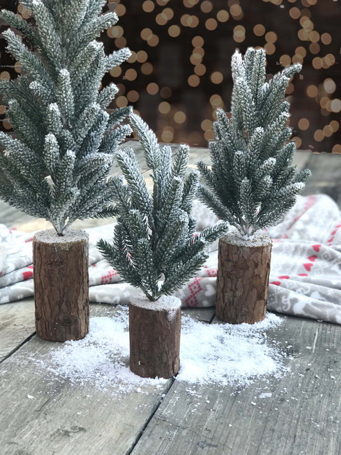 nordic mini Christmas tree covered in snow