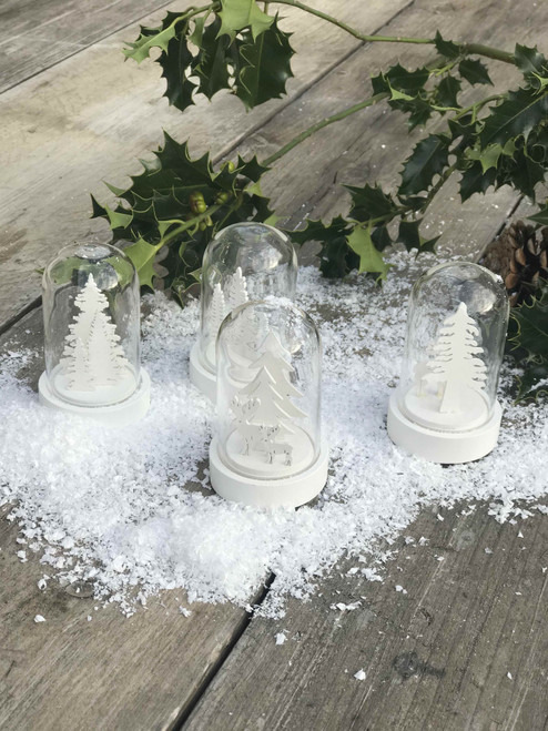 A warm white LED scenery cloche showing a delicate white plywood winter scene. Four assorted designs