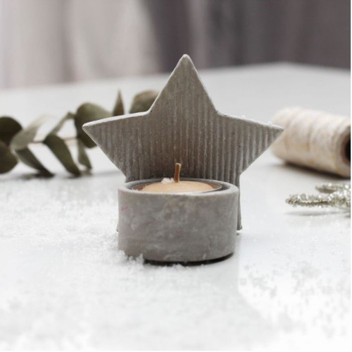 Tea light holder in an attractive star shape. These look wonderful with candlelight for a cosy winter's evening placed on the mantlepiece or mingled with an assortment of tealights.