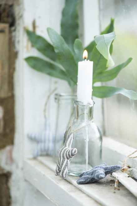 A small glass vase or candle holder ideal for a single flower stem or style with one of our many dinner candles