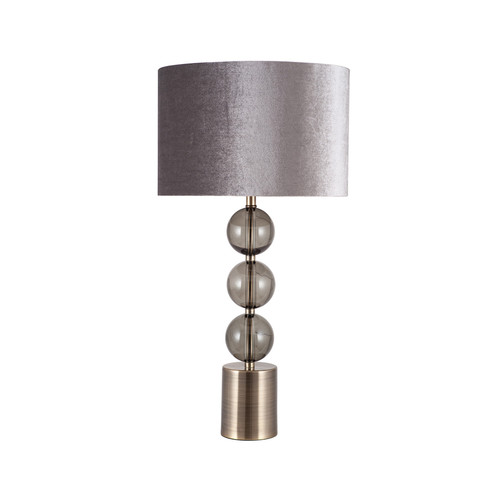 Three clear glass globes and brushed silver metal make this table lamp a beautiful statement piece for any room