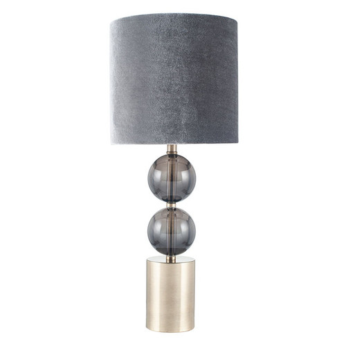 Two smoke glass globes and antique brass metal make this table lamp