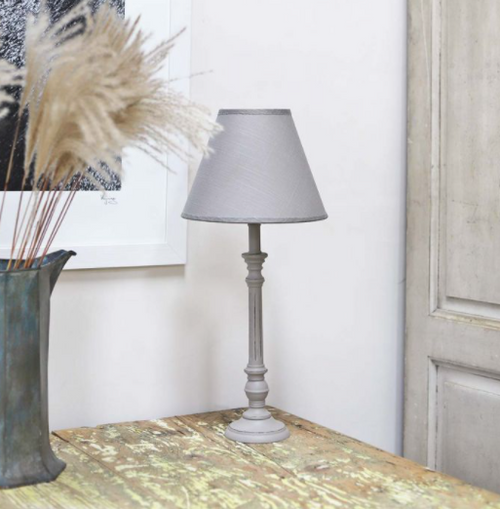 grey wooden lamp base featuring a grooved design with grey shade