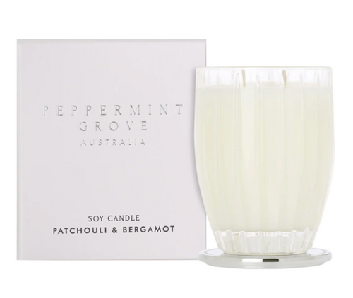 A fragrant soy candle in the scent patchouli and bergamot