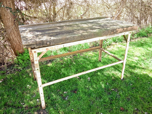 This former work bench is the perfect size for a kitchen island, pair with some bar stools for the perfect rustic addition to your interior.