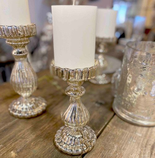 A Medium Antique Silver glass candle stick, also avaliable in small
