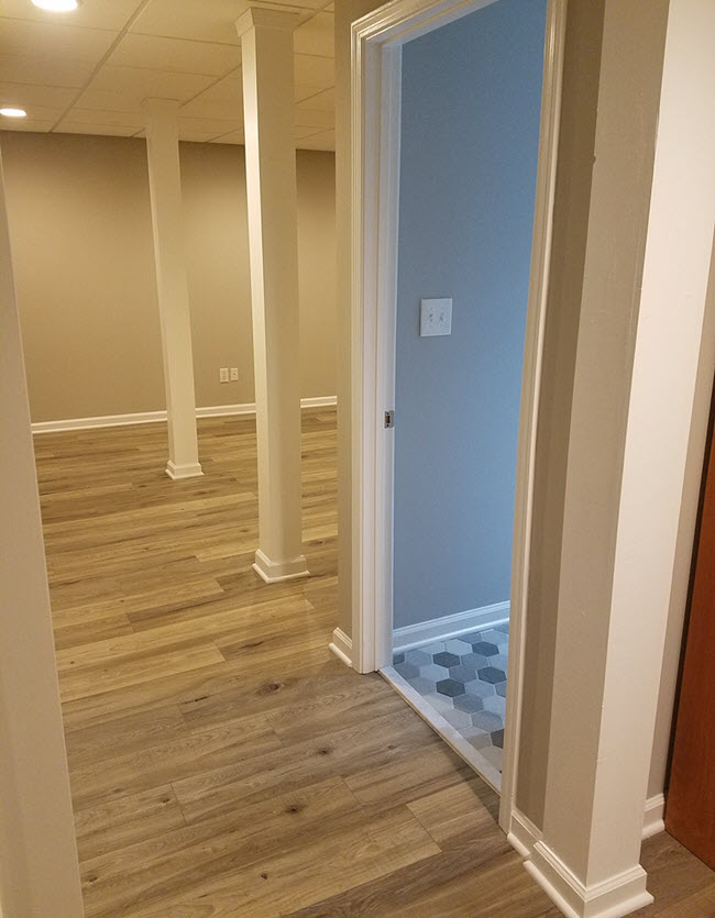 Basement remodel with LVT and peak into new bathroom