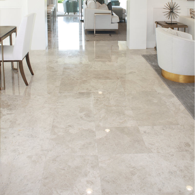 Polished floor tile to transition from one space to another