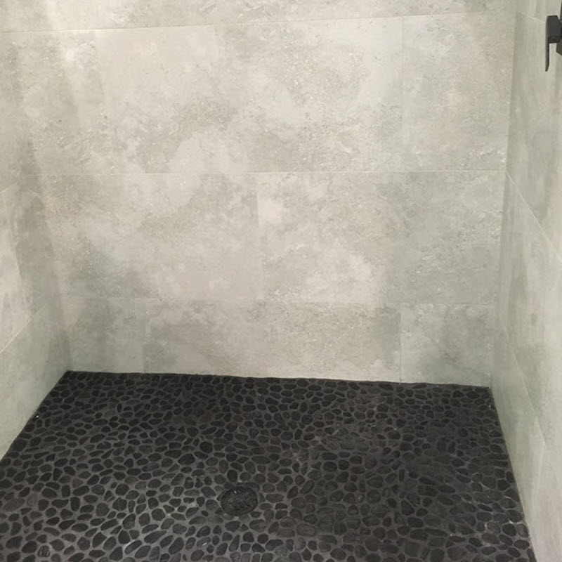 Use pebbles for your shower floor