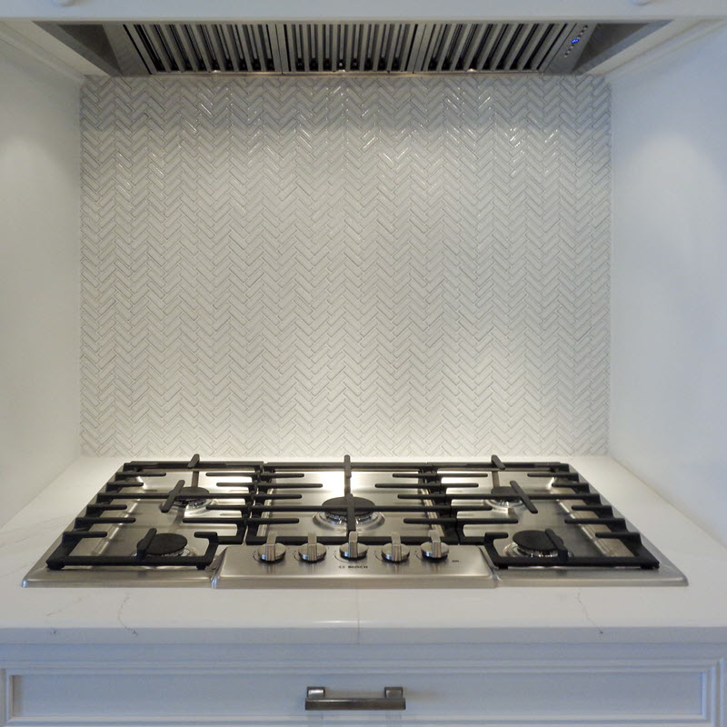 Marble herringbone mosaic backsplash