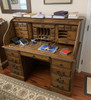 USB port and Two Plugs Built In For Easy Access Behind Top Center Drawer Panel Solid Oak Roll Top Deluxe Executive with Burnished Antique Medium Stain Double Pedestal with Locking File Drawers and Tambour Classic Antique Styling with Dove Tailed Drawers and Raised Panel Sides