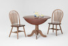 "42"" Round Drop Leaf Table  Solid Wood Only 24"" with leaves down Shown with Fanback Chairs  Dark Chestnut & Dusty Gray Finish"