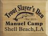 9x12 Butternut Stain board with Black text  Trout Slayer's Den  Manuel Camp  Shell Beach, LA  Est. 2014