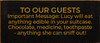7x3 Black board with Gold text  TO OUR GUESTS  Important Message: Lucy will eat anything edible in your suitcase. Chocolate, medicine, toothpaste - anything she can sniff out!