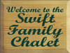9x12 Butternut Stain board with Dark Green text  Welcome To The Swift Family Chalet
